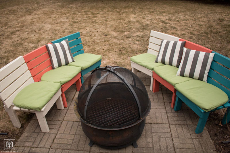 curved diy fire pit bench in rainbow colors with cushions