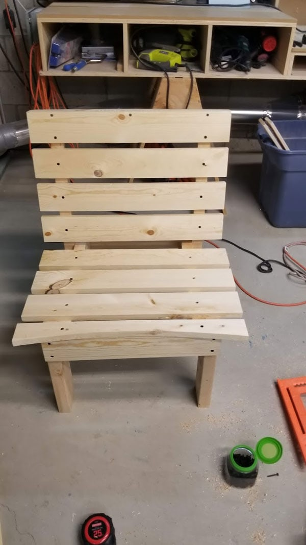 unpainted diy curved fire pit chair bench in basement