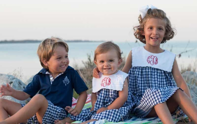 older siblings with baby on beach--tips for helping toddlers adjust to new baby