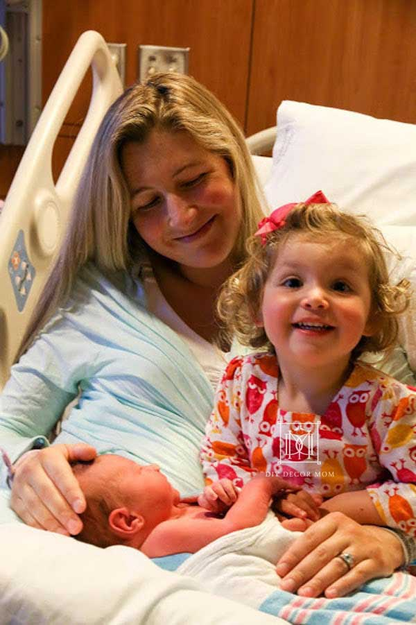 big sister and sibling meet for first time at hospital--see tips to help toddlers adjust to new baby