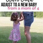 older child hugs pregnant mom belly--how to help your older child adjust to new baby