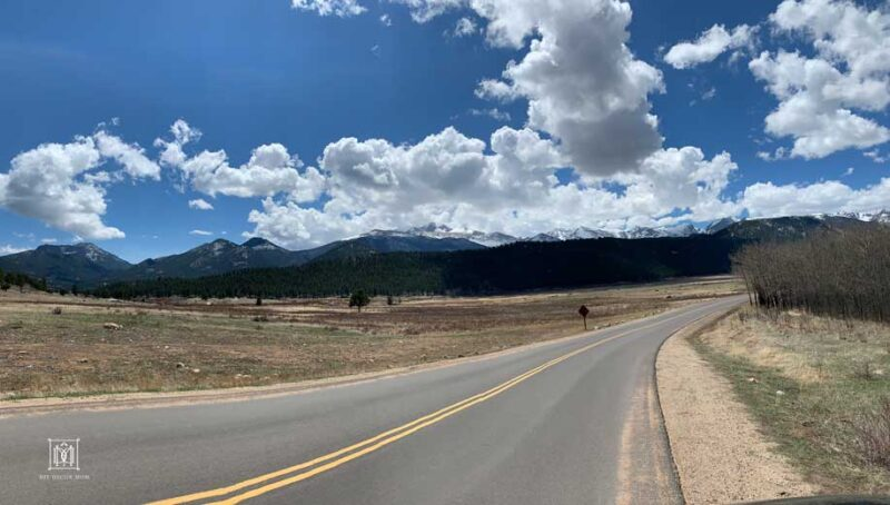 road with clouds in the background--road trip with kids activities and game ideas