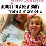 how to help your toddler adjust to a new sibling--toddler meeting new baby brother