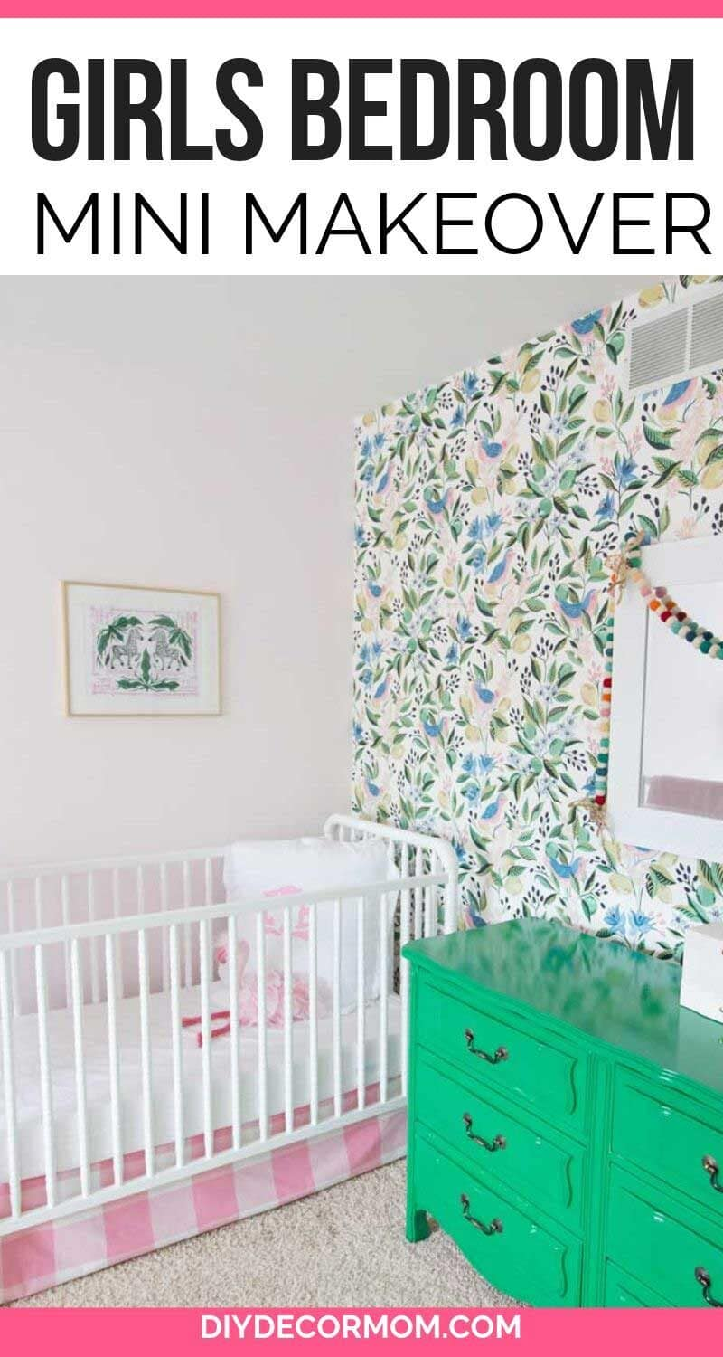 pink walls in girls bedroom with floral accent wallpaper in green