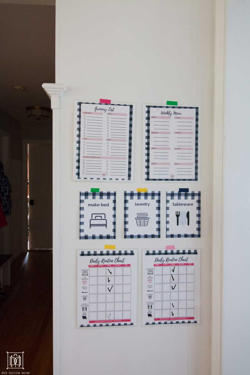 grocery list and daily chores printable for family on family command center on white wall