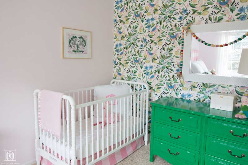 light pink painted girls bedroom with wallpaper
