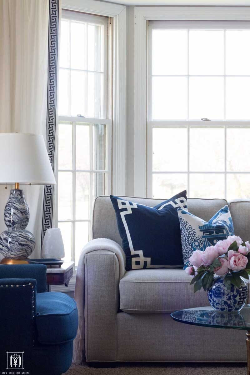 couch with blue and white pillows