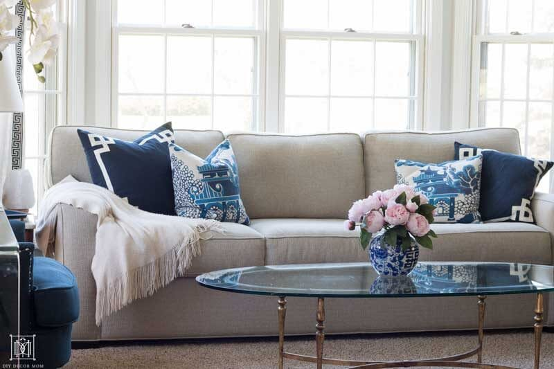 living room with blue and white pillows