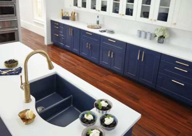 navy blue kitchen cabinets with white backsplash
