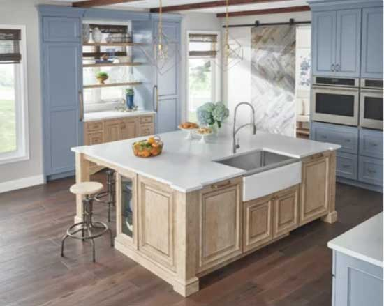 blue kitchen cabinets with wood island