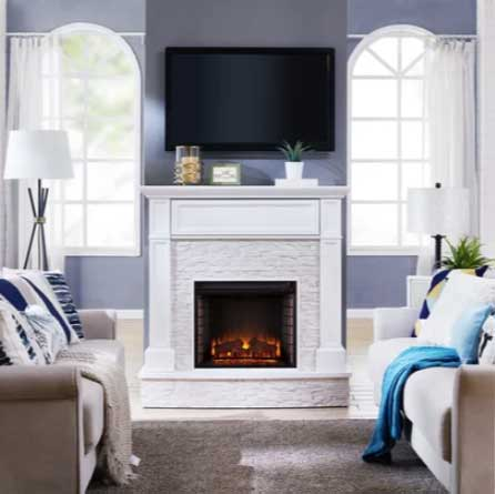 blue gray living room with white fireplace and tv