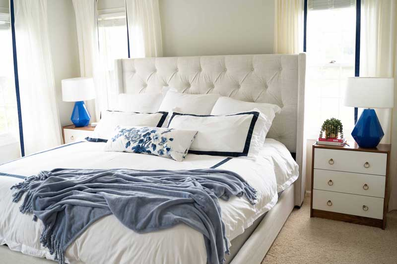 upholstered bed with cozy throw--tips to make a relaxing bedroom