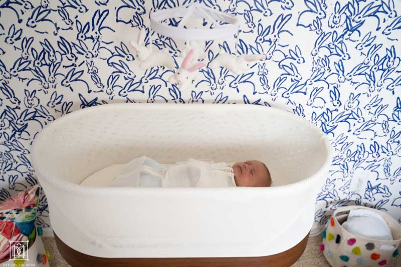 baby sleeping in a snoo smart sleeper in girls nursery