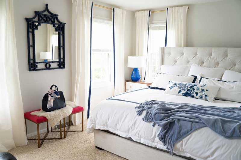 neutral master bedroom with blue and white accents