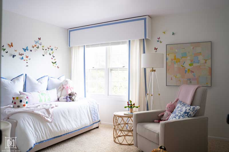 girl nursery reveal- white walls, blue and white curtains, abstract artwork