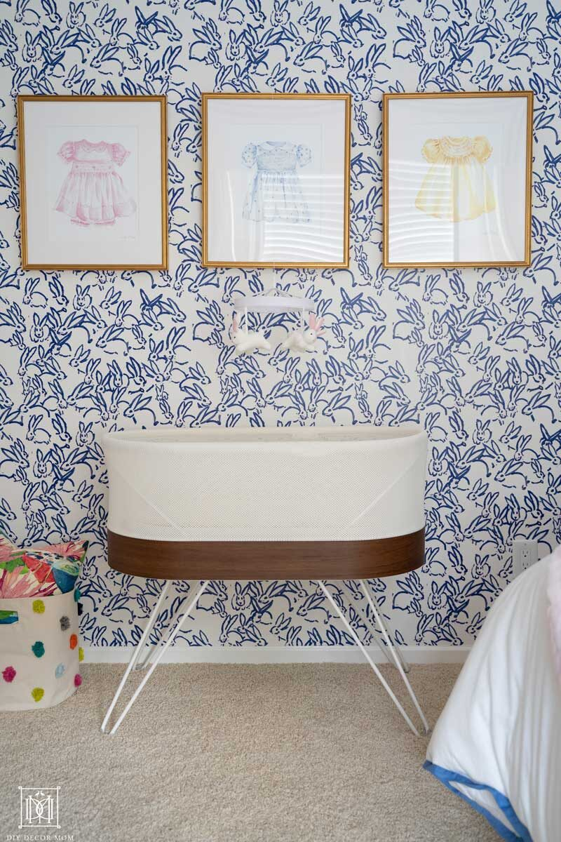 snoo in girls nursery with wallpaper accent wall
