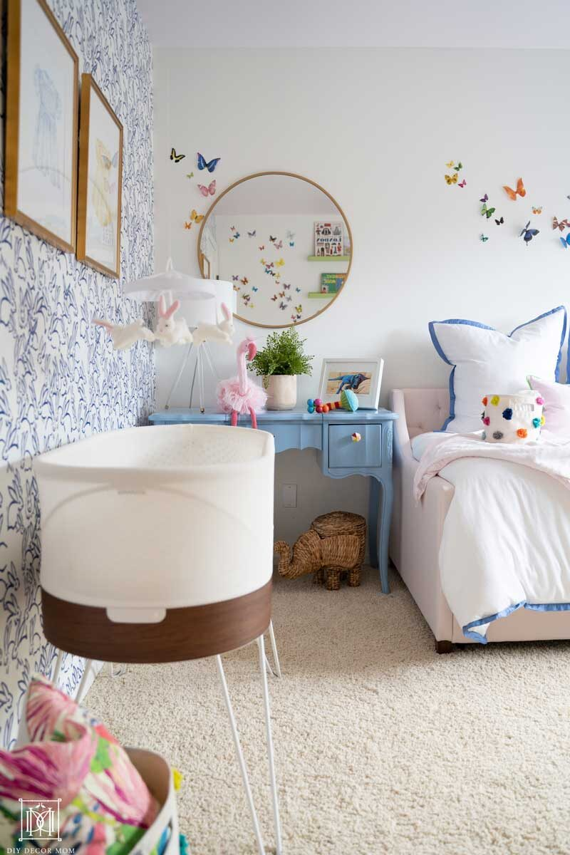 nursery with snoo smart sleeper and white walls