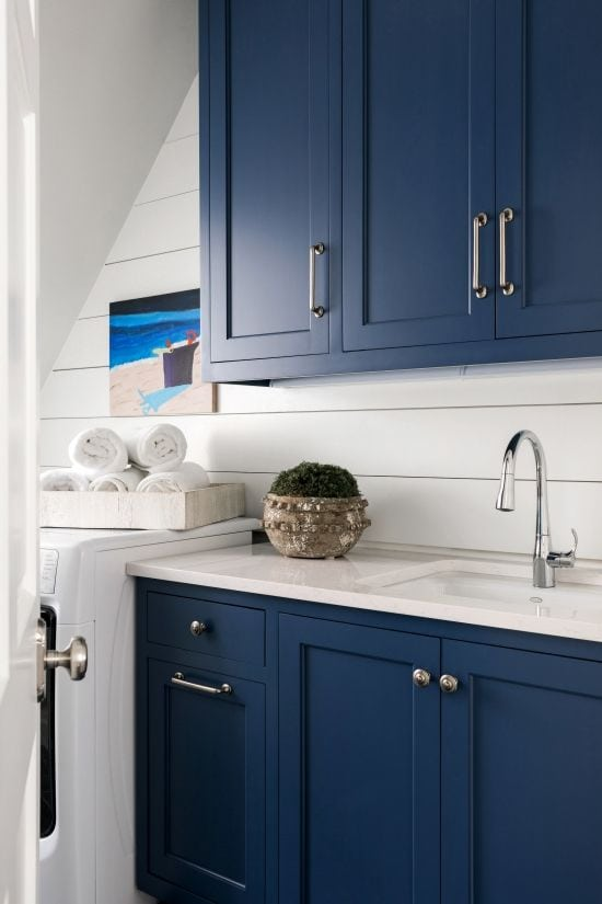 Sherwin-Williams cabinets in laundry room with white shiplap walls