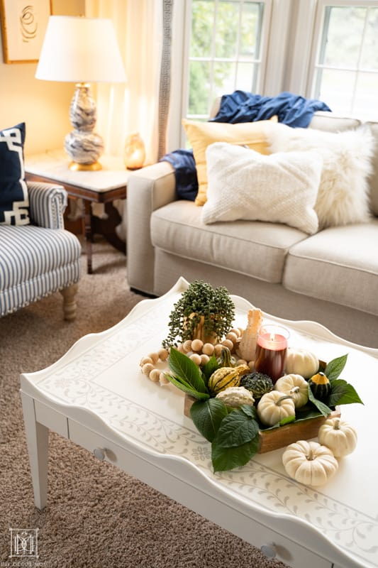 embracing hygge in your home and upping your cozy factor with soft pillows, candles, warm lights, and natural textures