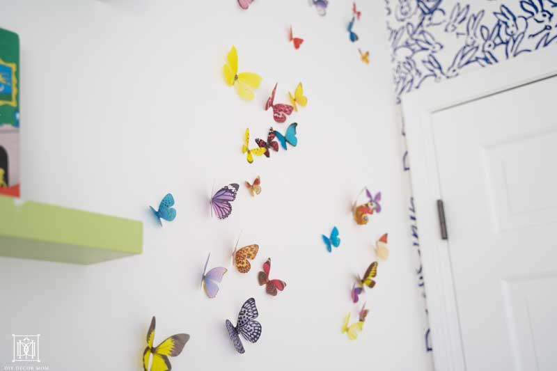butterfly wall decor in baby girl bedroom