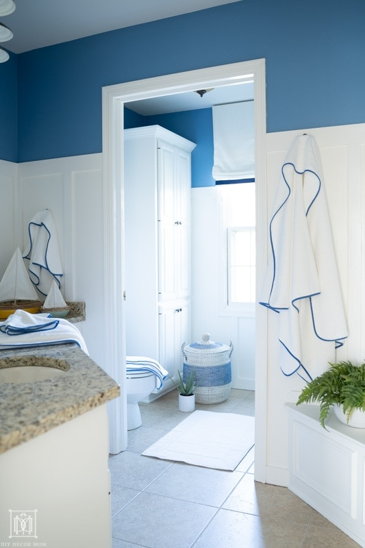 blue and white kids bathroom with new blue towels