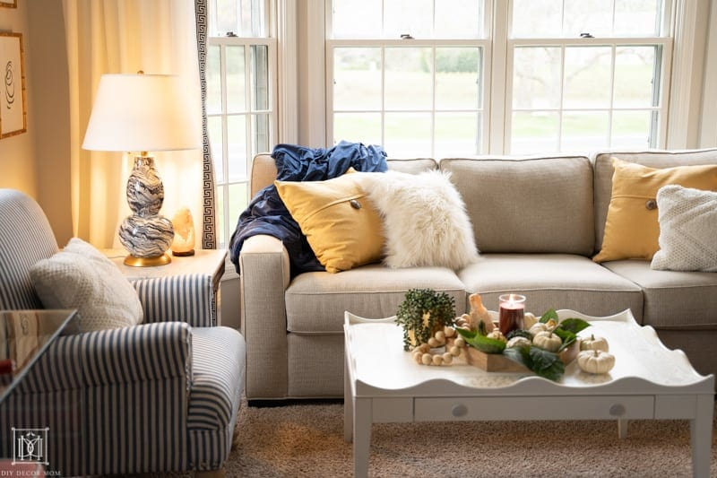 how to make your house have more hygge--light lamps, light candles, use soft textures and pillows