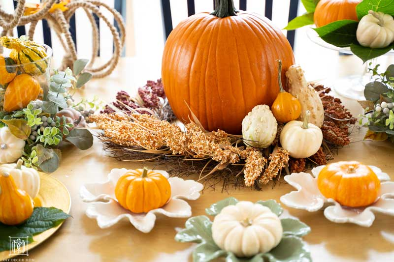 fall decorations with mini pumpkins on appetizer plates