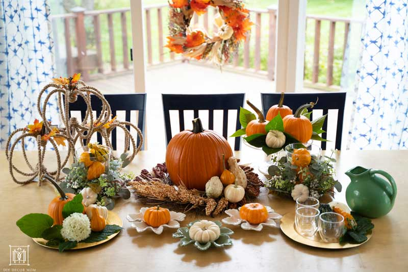 beautiful fall tablescape with pumpkins gourds and fall decorations