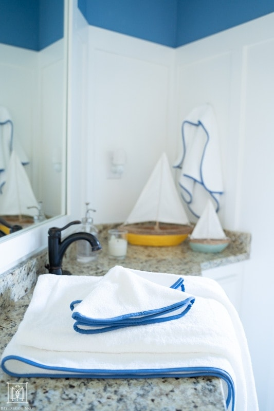 beautiful blue and white bathroom with white board and batten and fresh white towels