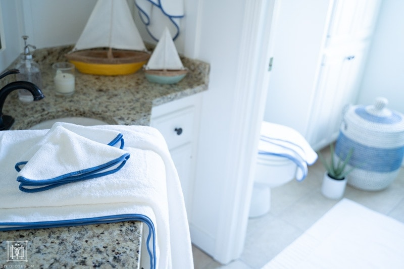 fresh white and blue towels in guest bathroom