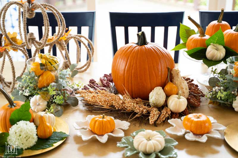gourds and mini pumpkins as fall decorations on table