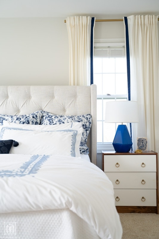 white curtains and blue and white bedding