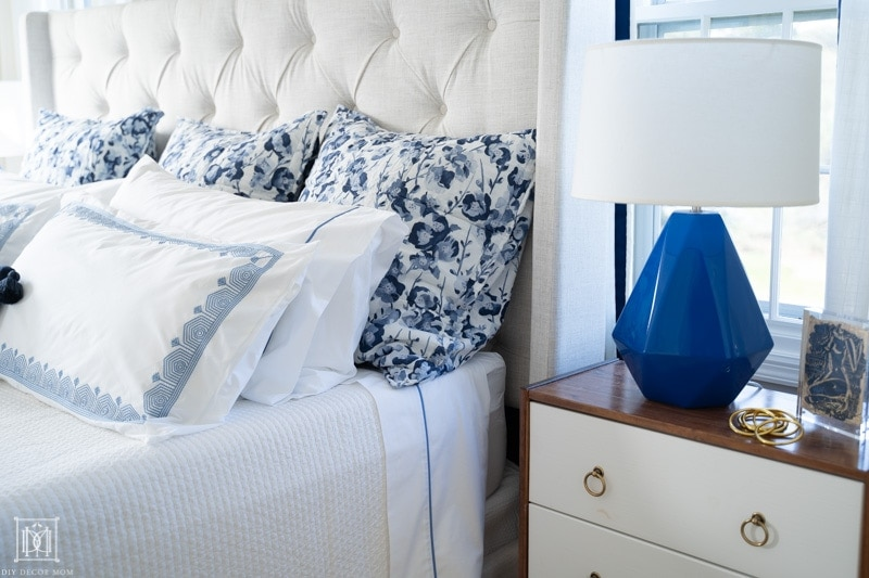 blue and white duvet cover with embroidery and floral euro pillows