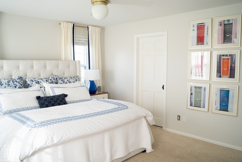 BM Classic Gray bedroom with white bedding and blue lamps