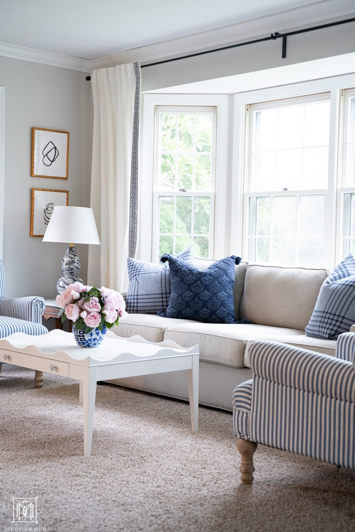 light gray painted living room with blue pillows