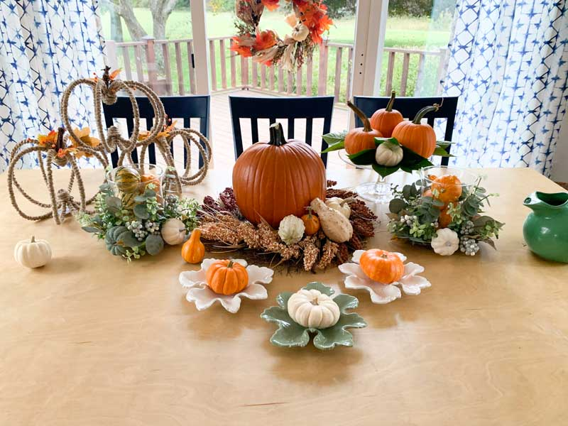 styled fall tablescape with harvest wreath on window