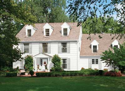 chantilly lace exterior on white colonial house with stonington gray shutters