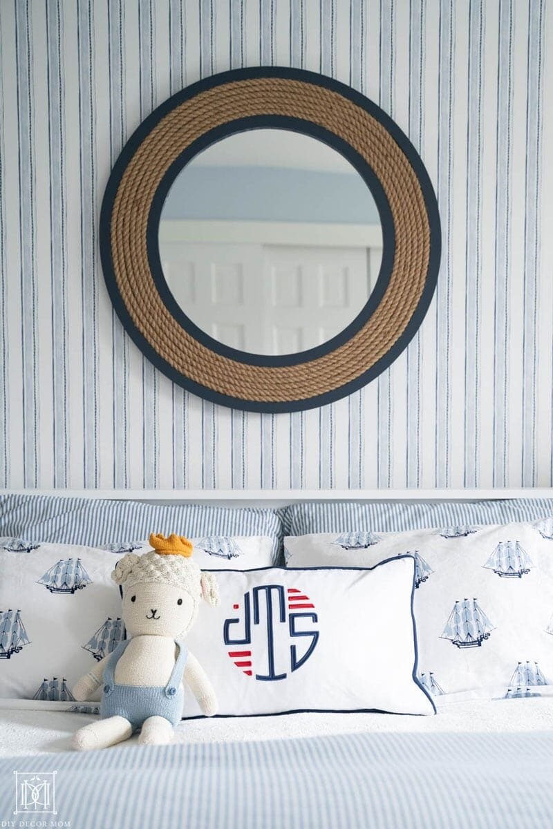 nautical mirror over bed