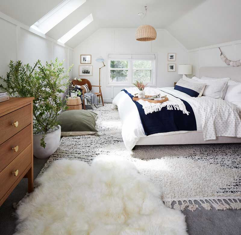 gorgeous bedroom with skylights