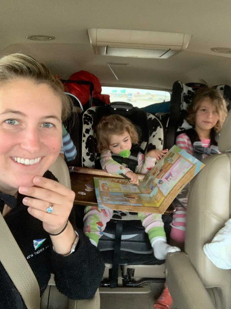 kids in back seat of car on road trip in car seats