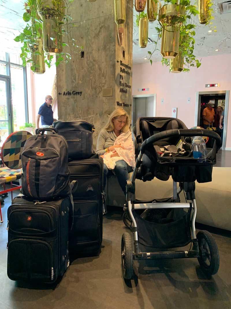 mom nursing newborn baby at hotel ounge