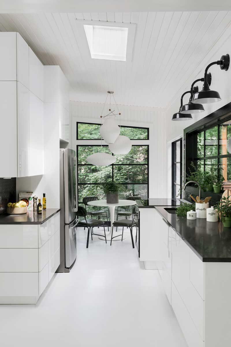 white modern kitchen with skylights