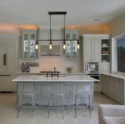 warm gray subtle painted cabinets in kitchen with lucite chairs and industrial light fixture