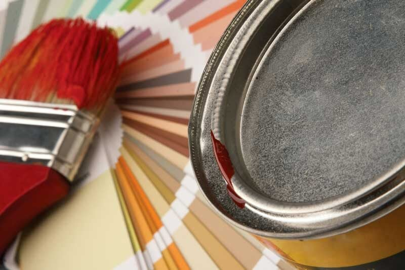 warm paint shades with paint brush with red paint