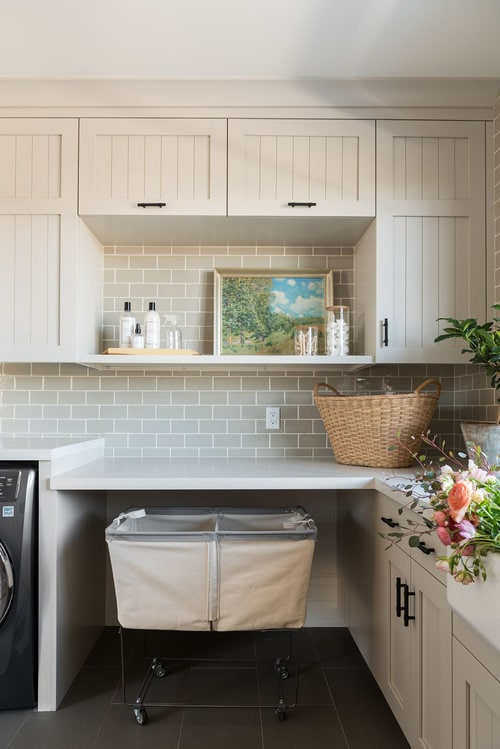worldly gray warm gray laundry room by Studio McGee