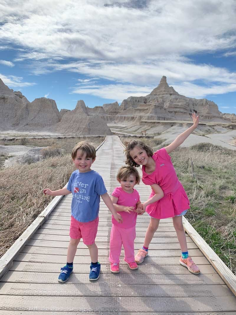 young kids posing in front of badlands national park