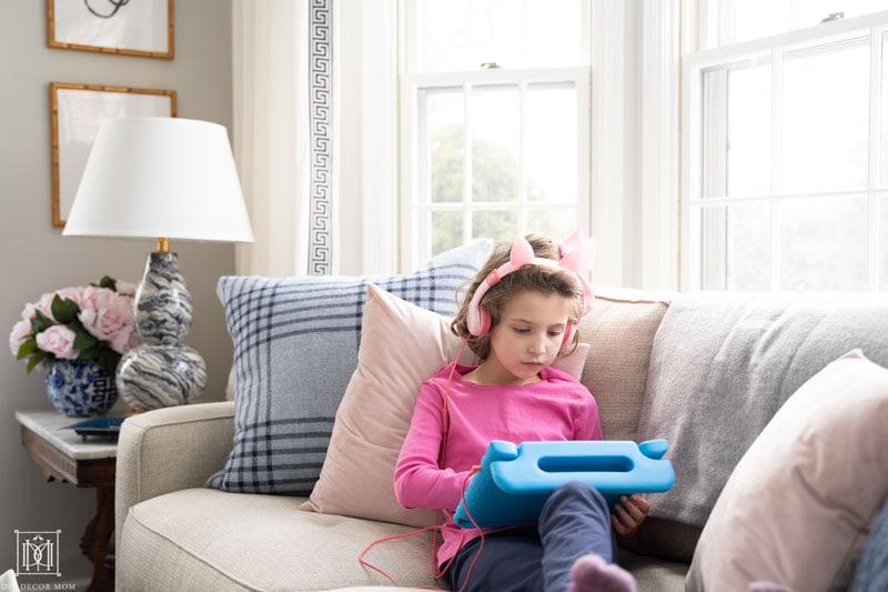 girl reading on ipad tablet