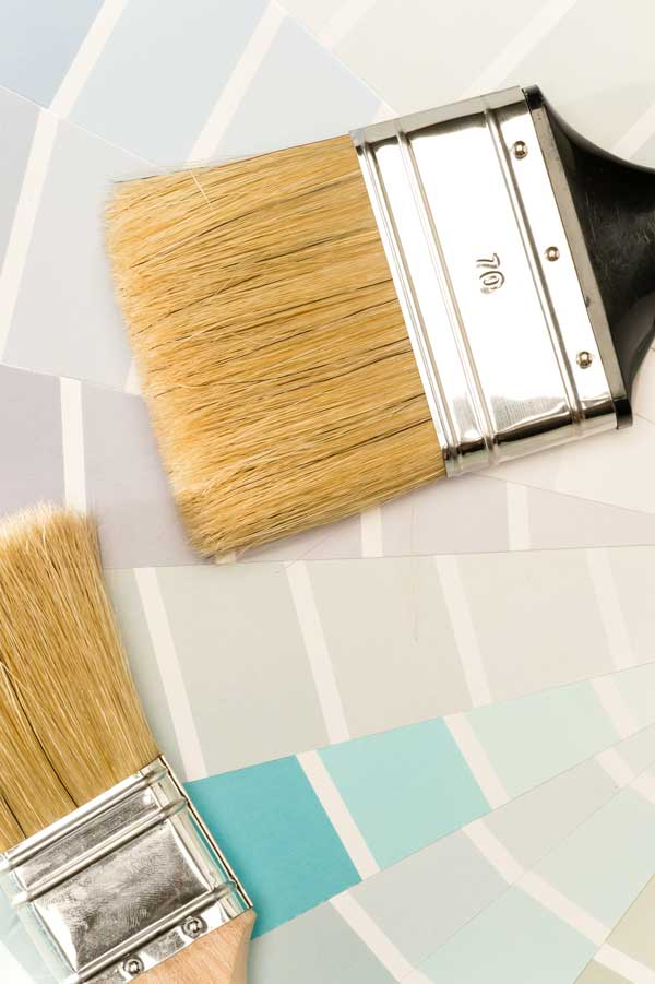 cool white paint shades and paint chips and a paint brush