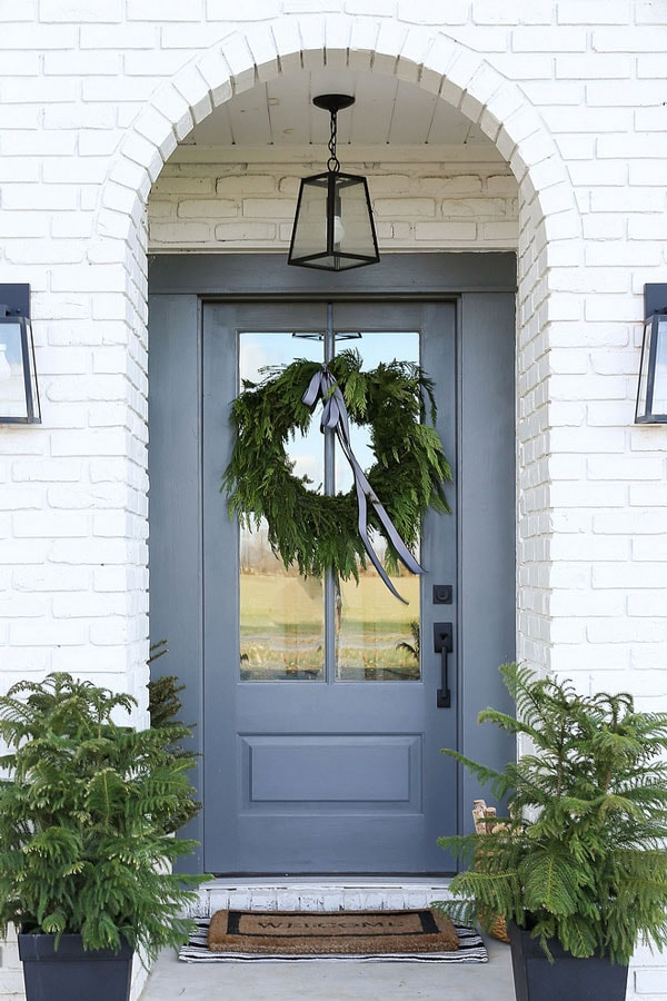 BM Chelsea Gray front door with white brick arched entryway