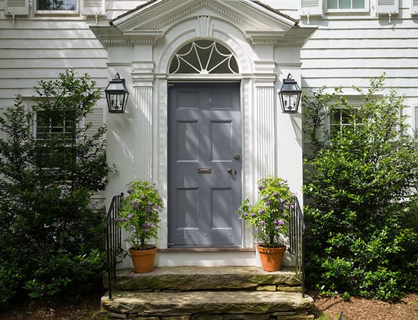 BM Platinum Gray front door on white colonial
